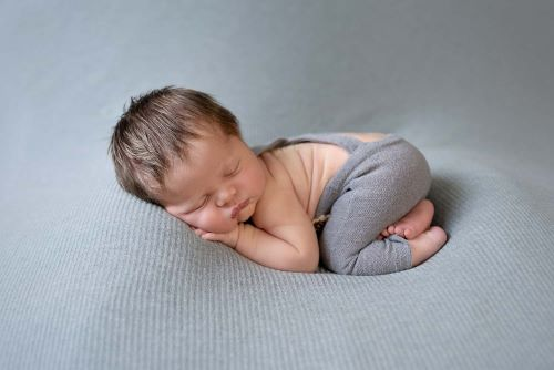 when should I book a newborn photographer?
